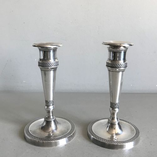 Pair of small tapered candlesticks in silver plated bronze with fluted friezes. …