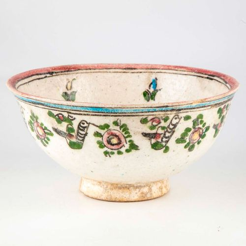 A glazed earthenware bowl decorated with flowers in the Persian style  H. 11 cm …