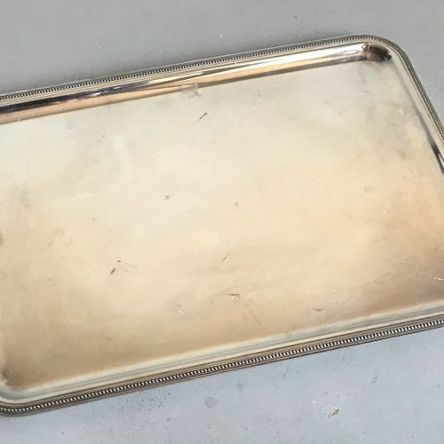 Rectangular serving tray with rounded edges in silver plated metal moulded with …