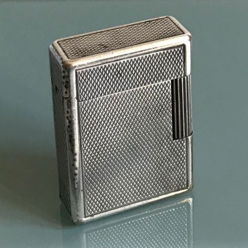 DUPONT House of St DUPONT  Lighter in silver plated metal with guilloche bottom …