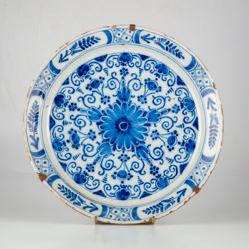 DELFT DELFT XIXth century  Dish in enamelled faience with blue and white decorat…