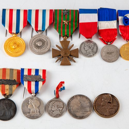 Set of medals including :   A war cross medal 1914 1918   Service medals of the …