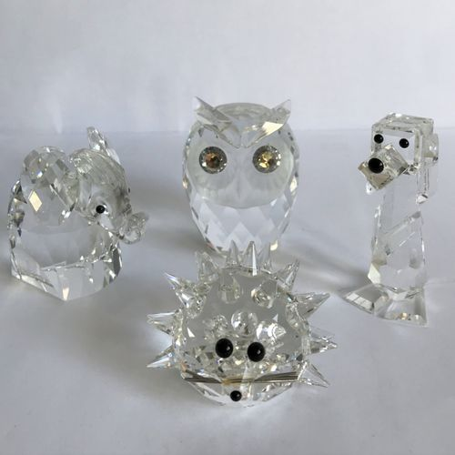 SWAROVSKI SWAROVSKI  Four cut crystal trinkets in the shape of small animals.  H…