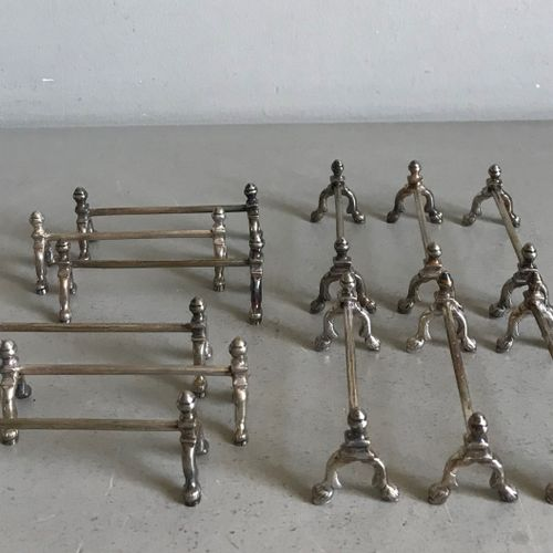 Twelve knife holders in the form of horse shanks in silver plated metal. Early 2…