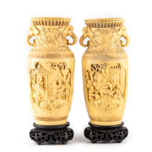 CHINE CHINA 20th century  Pair of vases in imitation of ivory, carved with scene…