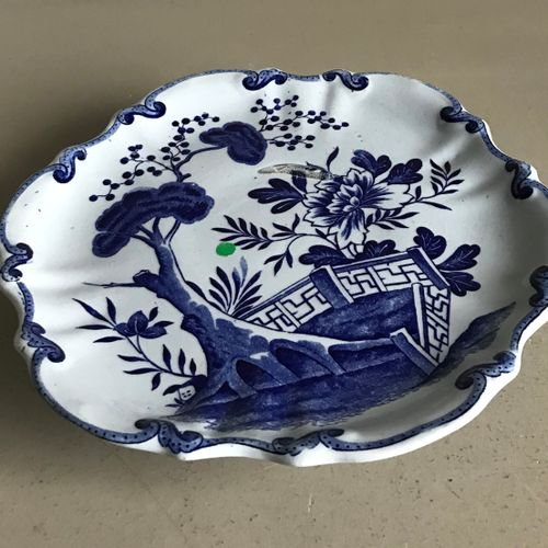 DELFT DELFT  Earthenware plate on foot with blue and white decoration in the Chi…