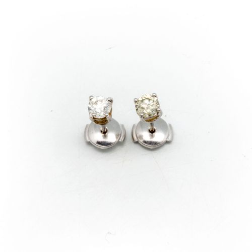 Pair of 18k white gold ear studs set with two diamonds weighing 0.30 ct. Each  G…