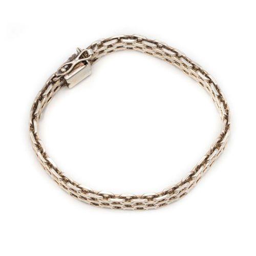 Bracelet gourmette en argent à maillons articulés et géométriques  Poids : 37,8 …