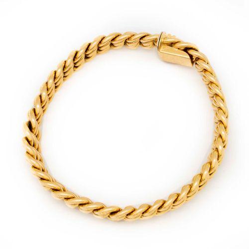 Bracelet en or jaune à maillons souples articulés  Poids : 26,4 g.