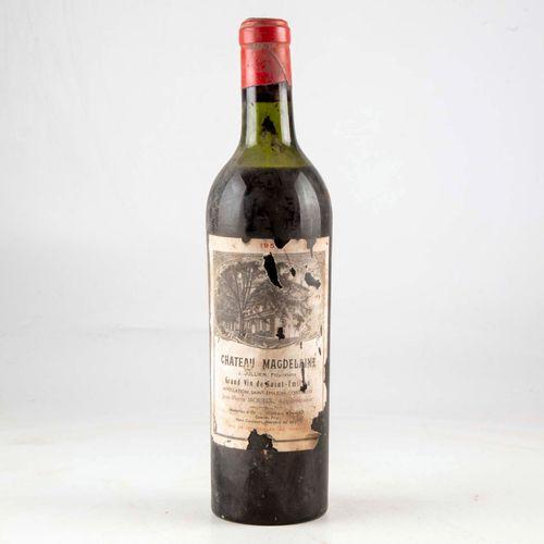 1 bouteille CHÂTEAU MAGDELAINE 1950 Saint Emilion  Niveau mi épaule  Etiquette f…