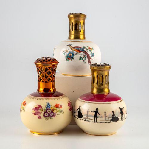 REVOL  Trois lampes BERGER en porcelaine à décor émaillé et doré des modèles :  …