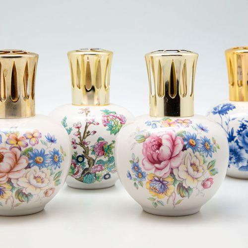 JARS JARS  Quatre lampes Berger en céramique à décor émaillé de fleurs  Marquées…