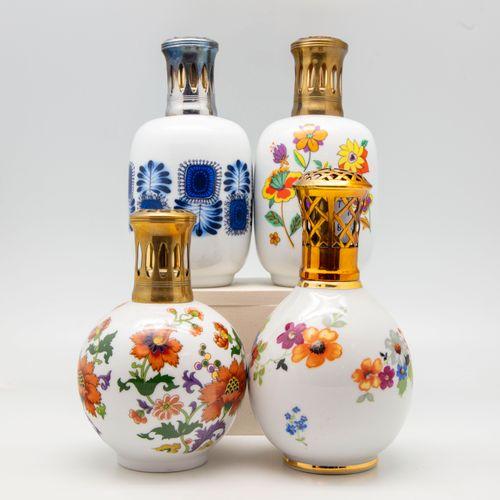 THARAUD THARAUD  Quatre lampes Berger en porcelaine à décor émaillé dont les mod…