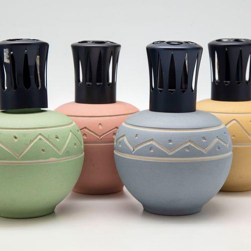 """Quatre lampes Berger en céramique à décor gravé géométrique modèle """"Les Ethnique…"""