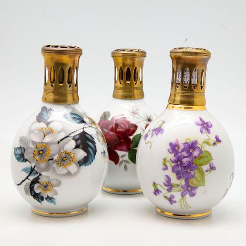 THARAUD THARAUD  Trois lampes BERGER en porcelaine à décor polychrome de fleurs …