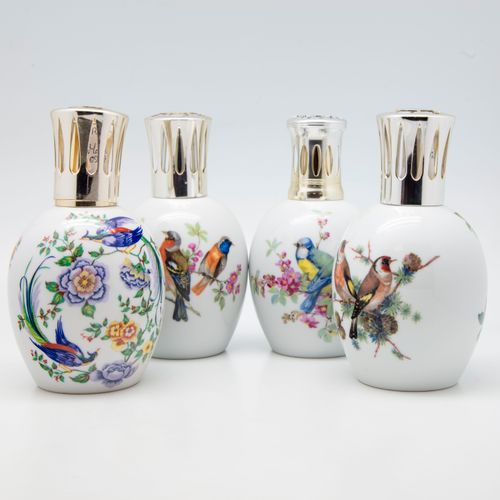 LIMOGES LIMOGES  Quatre lampes Berger en porcelaine à décor émaillé polychrome d…