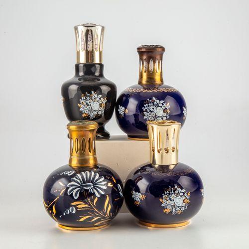 Revol REVOL  Trois lampes BERGER en porcelaine bleu à décor émaillé et doré modè…