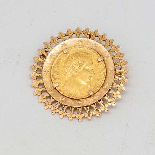 Broche, pendentif en or jaune orné d'une pièce de 20 francs or  Poids : 12,6 g.