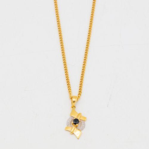 Chaine en or et pendentif en or orné d'une pierre bleue  Poids brut : 7,1 g.