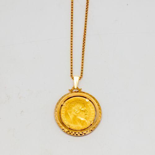 Chaine en or jaune ornée d'un pendentif agrémenté d'une pièce de 20 Francs or  P…