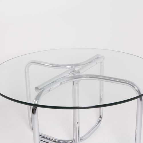 GIOTTO STOPPINO. Table in steel and glass 吉奥托 斯托皮诺(维格瓦诺,1926 米兰,2011)。圆桌,玻璃桌面,钢制…