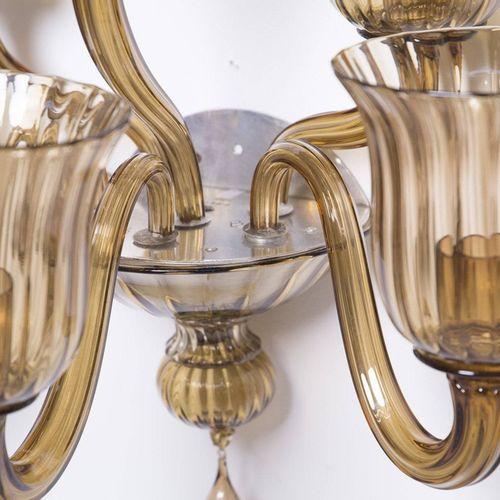 Two wall lamps in crystal glass. VENINI Paire d'appliques à trois lumières en cr…