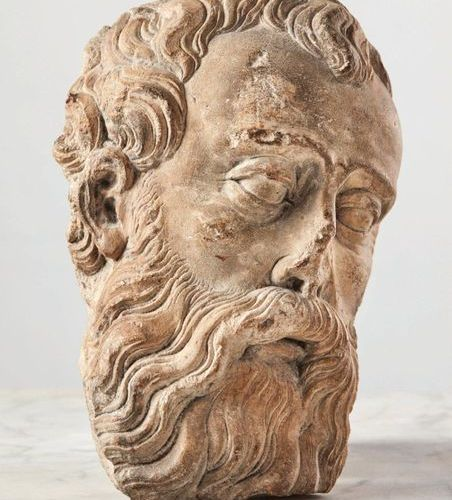 HEAD OF A BEARDED MALE head in limestone carved in high relief. Turned three qua…