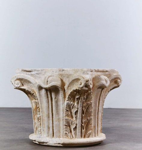 Carved limestone capital on all sides decorated with palmettes with smooth leave…