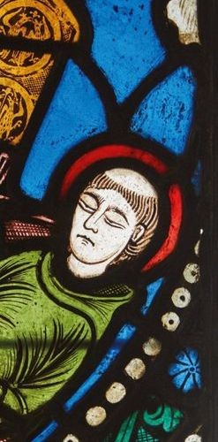 Stained glass stained glass window depicting two monks watching over the body of…