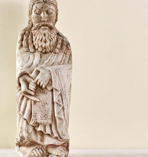 Carved marble prophet. Standing with his bare feet turned to the right, the sain…