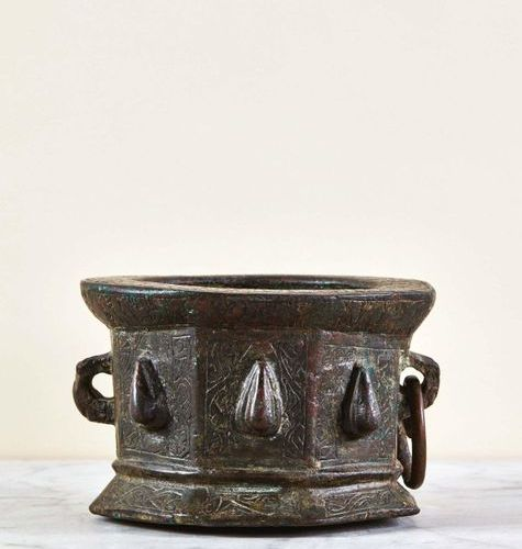Bronze mortar of octagonal shape with engraved decoration with two holds, one wi…