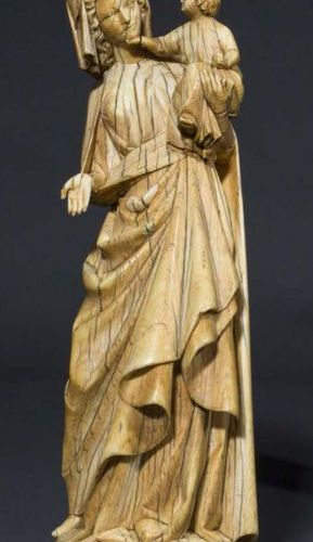 Virgin and Child in carved ivory with rare polychrome remains. Standing with a s…