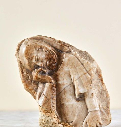 Fragment of an alabaster weeper carved in bas relief with minute traces of gildi…