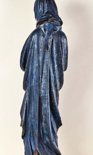 Virgin of Calvary in wood carved in the round and polychromed. Standing with a s…