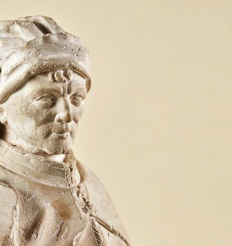 Carved limestone Saint Bavon, sketched back. Represented as a civil figure like …