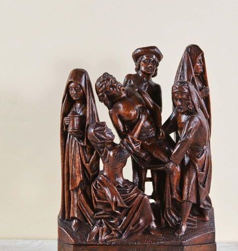 Descent of cross in carved oak, altarpiece group. Nicodemus in the background, m…