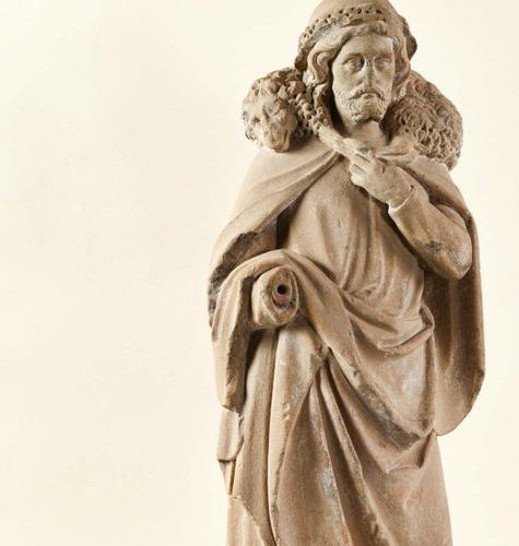 Christ the Good Shepherd in stone carved in the round. Standing, the Good Shephe…