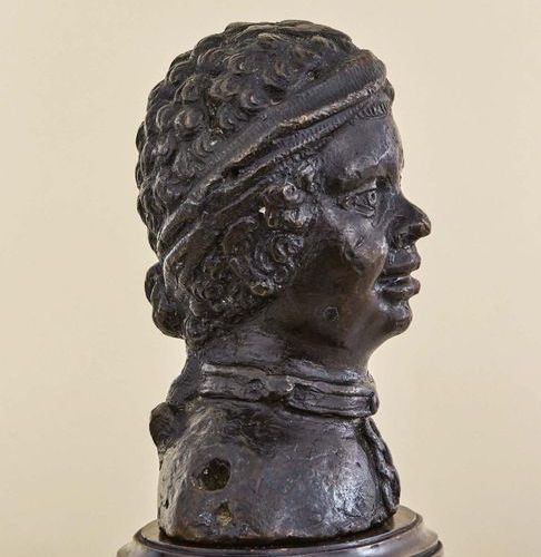 Bust of a young African slave in bronze with brown patina. Wearing an iron neckl…