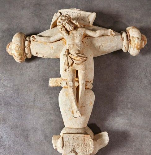 Christ on the cross with a carved limestone crown. Ovoid branches with flattened…