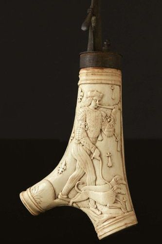 Powder flask made of deer antlers carved in bas relief of a foot soldier blowing…