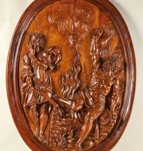 Large carved fruitwood medallion in high relief representing Philoctetes setting…