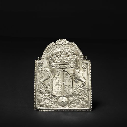 A silver Torah shield Galicia, 1787 This shield is decorated with exquisite flor…