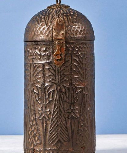 Cylindrical box with domed lid, wooden core covered with embossed leather with s…