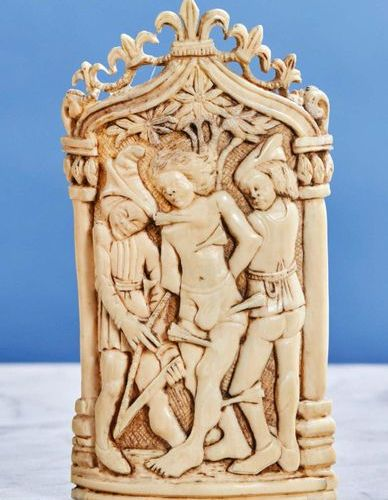 Kiss of Peace in carved ivory representing the martyrdom of Saint Sebastian on a…