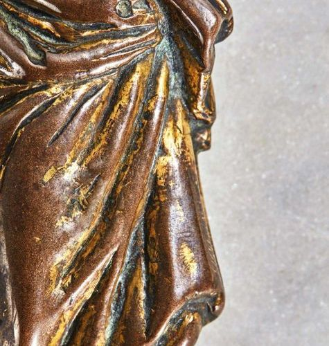 CHRIST in gilt bronze, hollow cast iron. Head encircled by a floral crown strong…