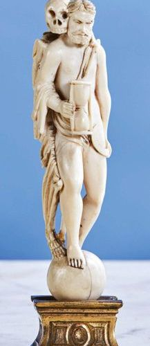 Allegory of Time in ivory finely carved in the round. Standing on a globe, the a…