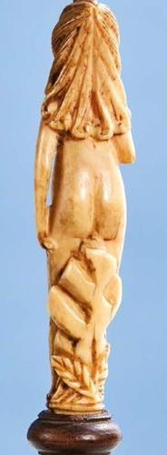 Handles of a carved ivory cutlery representing Adam and Eve. Standing, each hold…
