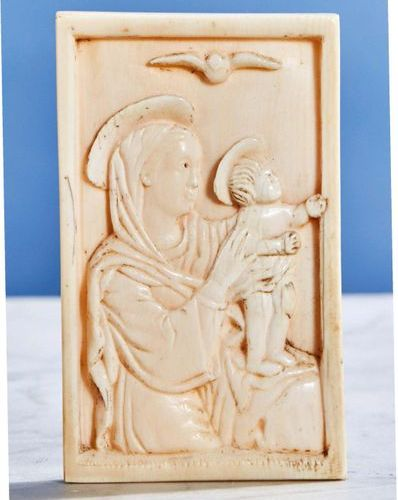 Carved ivory plaque representing the Virgin and Child in bust and in profile Ind…