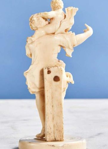 Carved ivory Saint Christopher. The Christ Carrier has his face turned towards t…