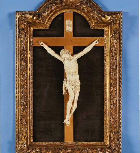 Large crucifix painting with Christ in ivory. Head with closed eyes inclined on …